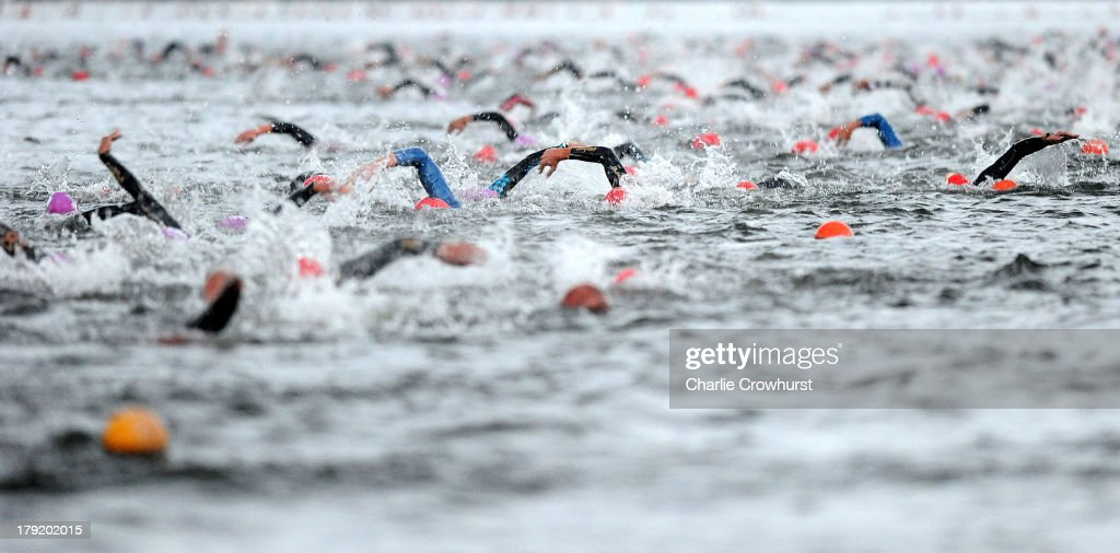 Participants swim during the Challenge Triathlon Vichy on September 01, 2013 in Vichy, France.