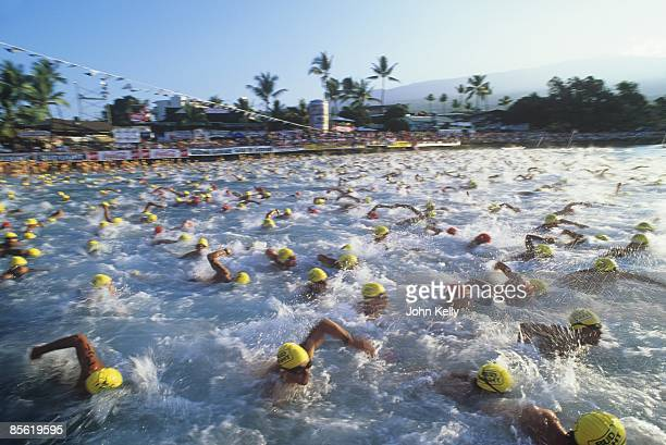 Participants swim past during the start of the 1990 Ironman Triathlon in October 1990 in Kona Hawaii