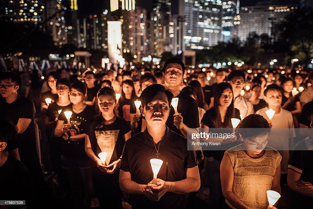 Participants take part at the candlelight vigil as they hold candles at Victoria Park on June 4 2015 in Causeway Bay Hong Kong Hong Kong residents...