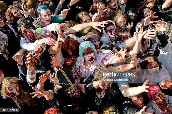 Participants take part at the Zombie Walk Duesseldorf along the Rheinuferpromenade on September 6 2015 in Duesseldorf Germany A zombie walk is an...