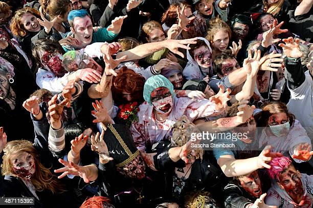 Participants take part at the Zombie Walk Duesseldorf along the Rheinuferpromenade on September 6 2015 in Duesseldorf Germany A zombie walk is an...