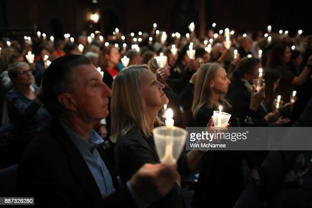 Participants take part in a candlelight vigil as part of the 5th annual National Vigil For Gun Violence Victims at St Mark's Episcopal Church...