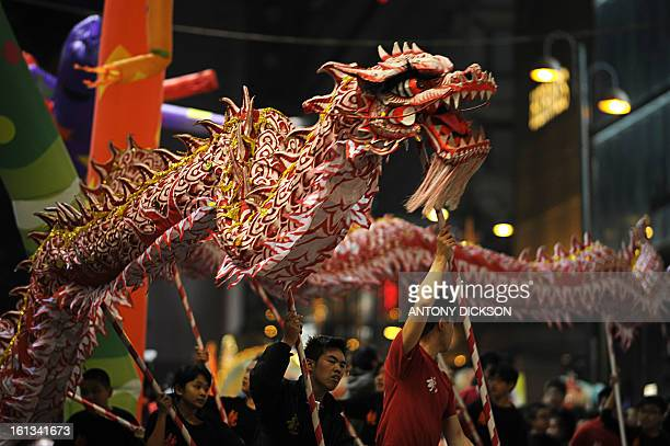 Participants take part in a dragon dance for the Chinese lunar new year parade through the streets of Hong Kong on February 10 2013 Chinese lunar new...