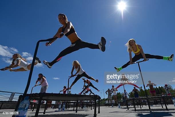 Participants take part in a fitness training event during the Velo Picnic Open Air festival in Minsk on June 27 2015 AFP PHOTO / MAXIM MALINOVSKY