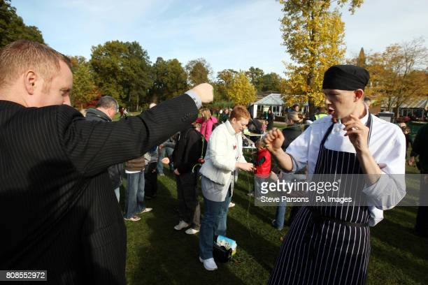 Participants take part in a Guinness World Record attempt for the most simultaneous conker matches at one time at the RHS Garden Wisley near Woking...