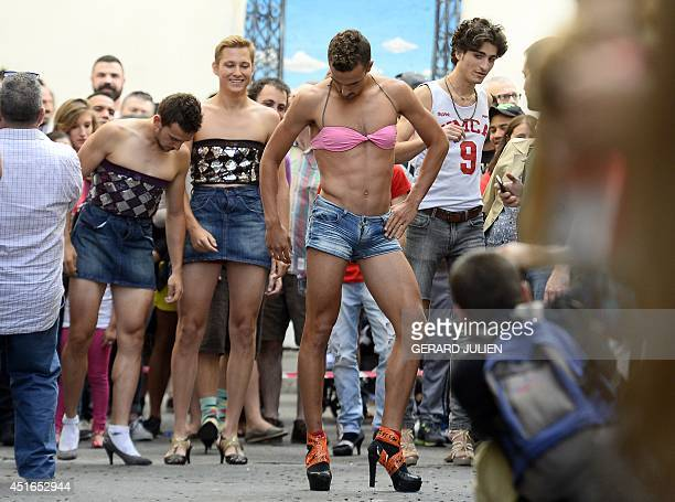 Participants take part in a highheel race at a Gay Pride party in the central neighborhood of Chueca in Madrid on July 3 2014 AFP PHOTO / GERARD...