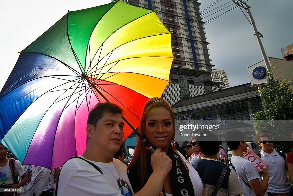 Participants take part in a parade during the Manila gay pride march on December 7, 2013 in Manila, Philippines. The march was held to celebrate the approval of anti discrimination ordnances in a handful of cities as well as the filing of the Anti Discrimination Bill before the Lower House of the Philippine legislature. The march is in its nineteenth year, making it the longest running celebration of its kind in Asia according to organizers.