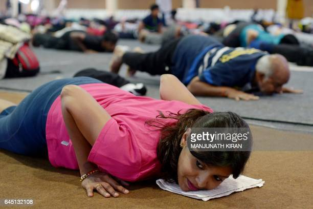 Participants take part in a yoga and selfdefence lesson for women at the Akshar Power Yoga Foundation in the Indian city of Bangalore on February 25...