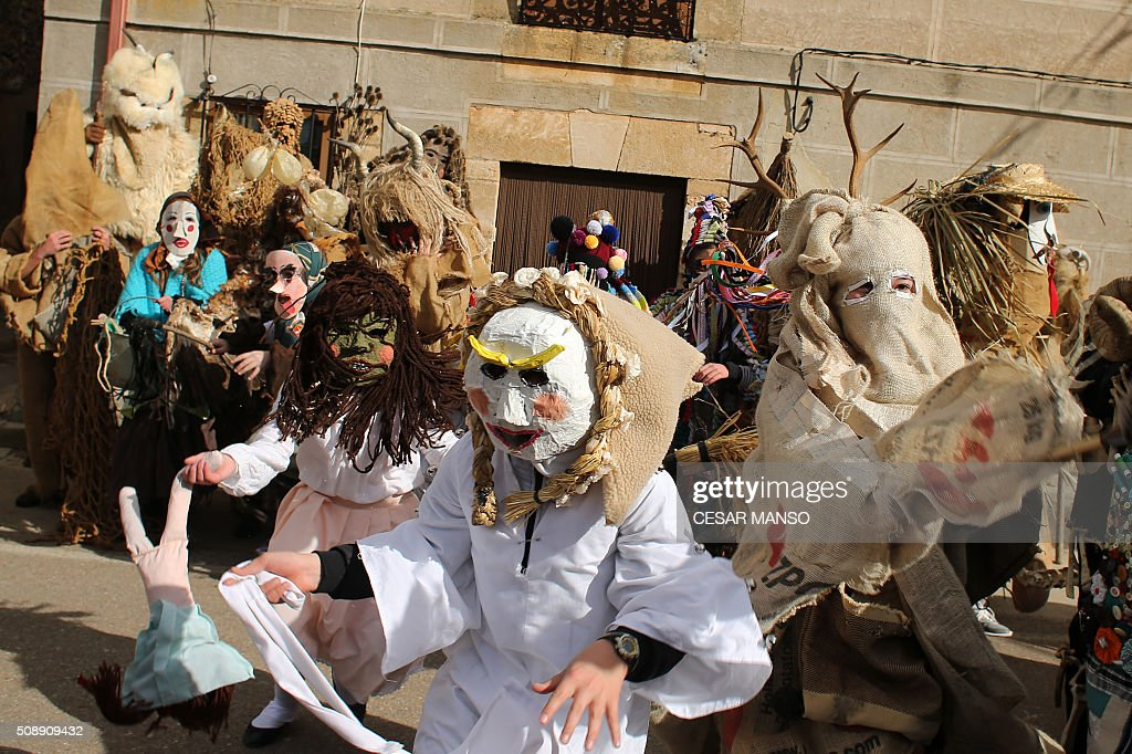 Participants take part in 'El Gallo de Carnaval' (The Carnival's Cock) in Mecerreyes, in the northern Spanish province of Burgos, on February 7, 2016. The Gallo Carnival is a pagan festival in which people participate singing, dancing and attacking the 'Gallo' that is defended by Zarramacos. AFP PHOTO / CESAR MANSO / AFP / CESAR MANSO