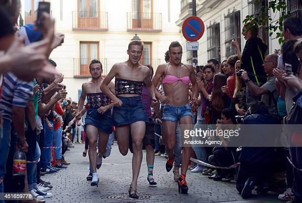 Participants take part in Gay Pride highheel race in Madrid Spain on July 3 2014