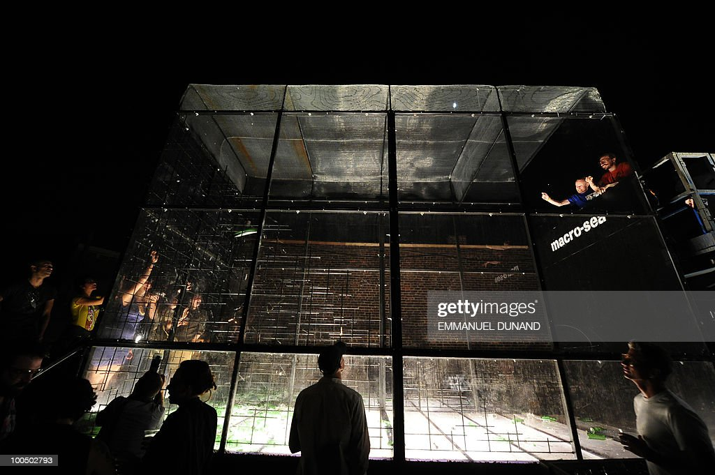 Participants take part in 'Glassphemy!', a project from artist and developer David Belt, on May 20, 2010, in Brooklyn, New York