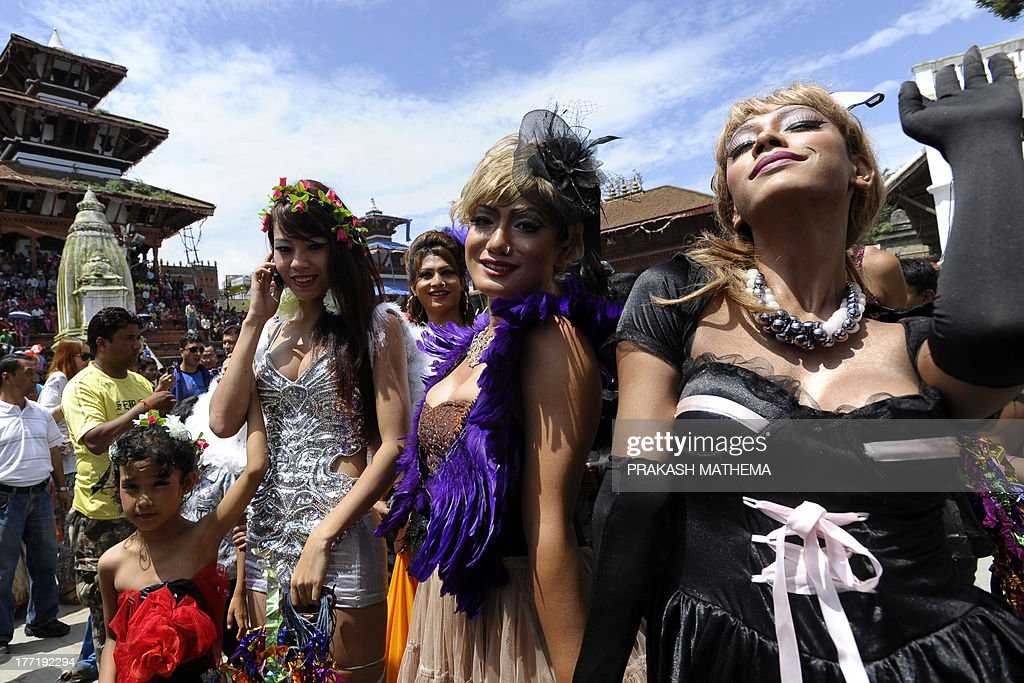 Participants take part in Nepal's 4th International Gay Pride parade in Kathmandu on August 22, 2013. Scores of gays, lesbians, transvestites and transsexuals from across the country took part in the rally to spread their campaign for sexual rights in the country. AFP PHOTO/Prakash MATHEMA