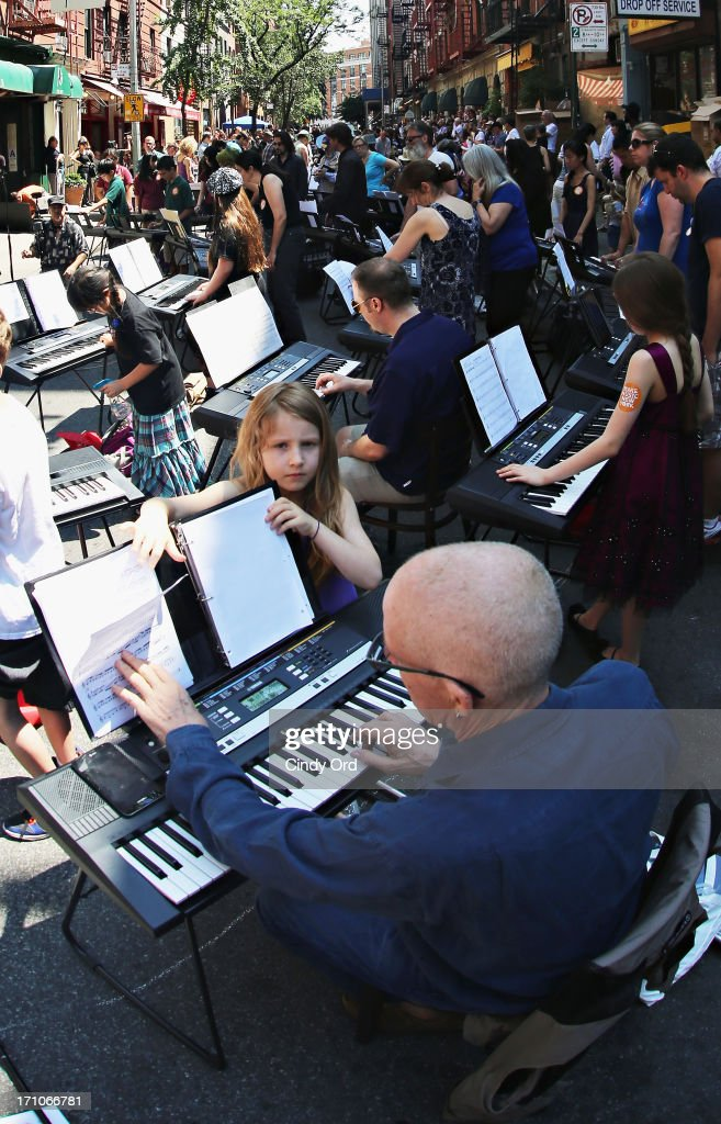 Participants take part in setting the Guiness World Record for the largest keyboard ensemble duing The National Association Of Music Merchants (NAMM) NAMM Presents First Ever National Music Day And Make Music NY at Cornelia Cafe on June 21, 2013 in New York City. 175 keyboards play together breaking Guinness world record on National Music Day as part Of Make Music NY. Keyboards to be donated to NYC Public Schools by Yamaha and Viacom following the event.