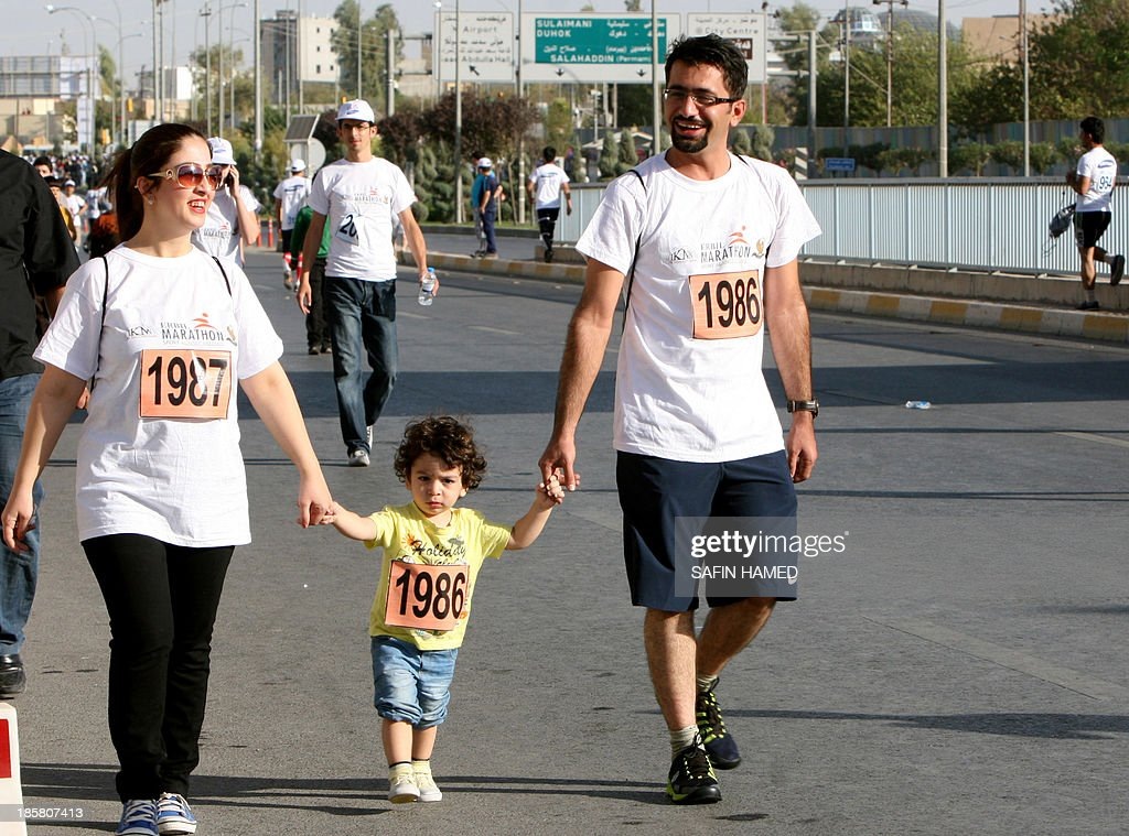 Participants take part in the '3rd International Erbil Marathon' in the northern city of Arbil, capital of Iraq's Kurdistan, on October 25, 2013. The marathon was organised under the motto of 'Let us run for peace and development'.