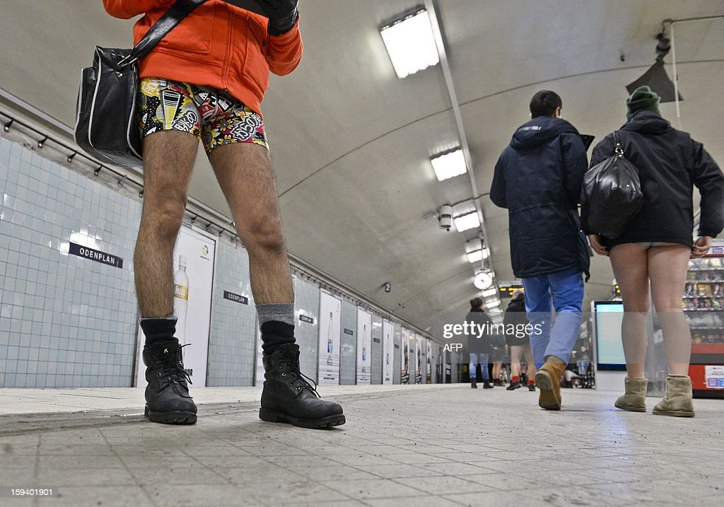 Participants take part in the annual 'No Pants Subway Ride' in Stockholm, on January 13, 2013. The yearly prank, organized by New York City-based prank collective Improv Everywhere was started in 2002, asking participants to ride subway lines pants-free and act straight-faced about it. AFP PHOTO / JANERIK HENRIKSSON /SCANPIX SWEDEN/ SEDEN OUT