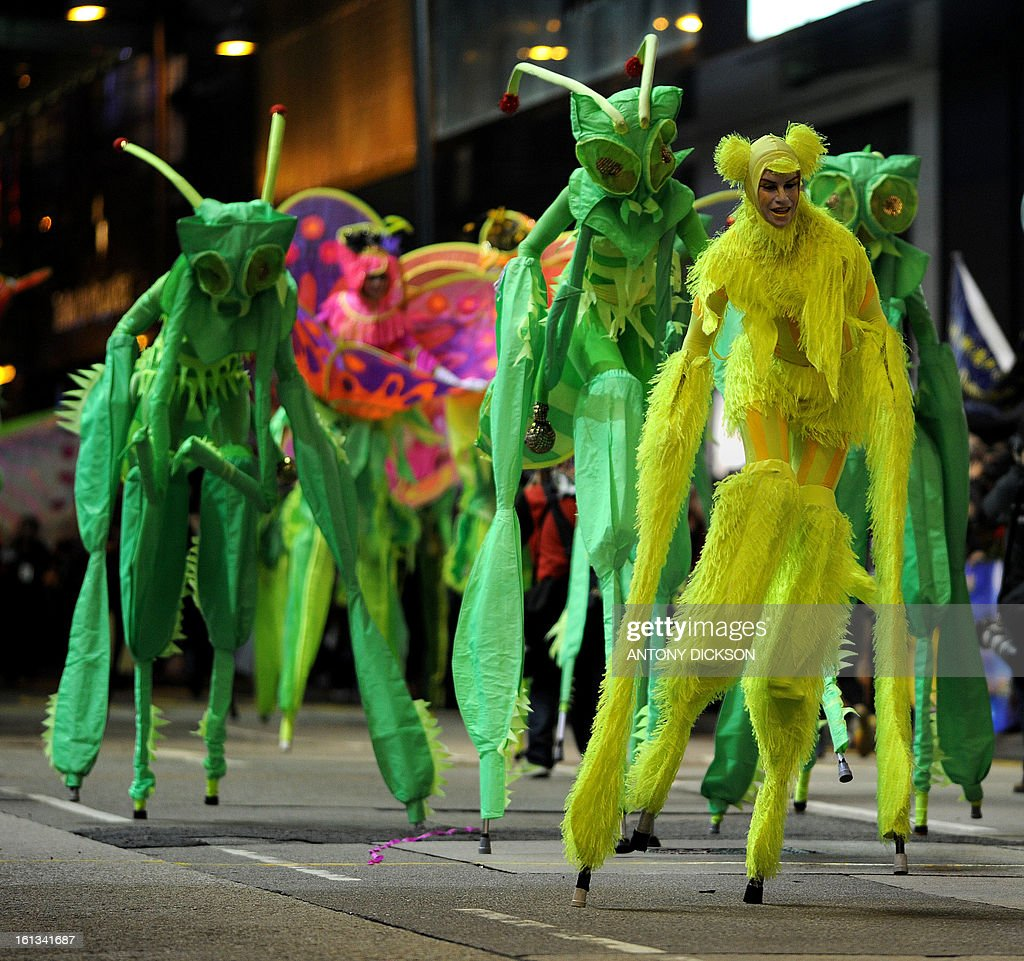 Participants take part in the Chinese lunar new year parade in the streets of Hong Kong on February 10, 2013. Chinese lunar new year, celebrated by Chinese communities the world over, falls on February 10 with the beginning of the new moon. AFP PHOTO / Antony DICKSON