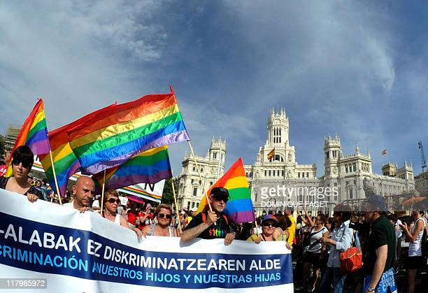 Participants take part in the gay and lesbian pride parade in the center of Madrid on July 2 2011 AFP PHOTO / DOMINIQUE FAGET