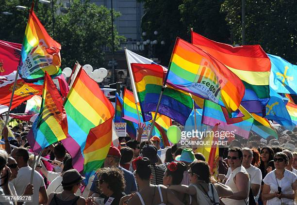 Participants take part in the gay and lesbian pride parade in the center of Madrid on June 30 2012 AFP PHOTO/DOMINIQUE FAGET