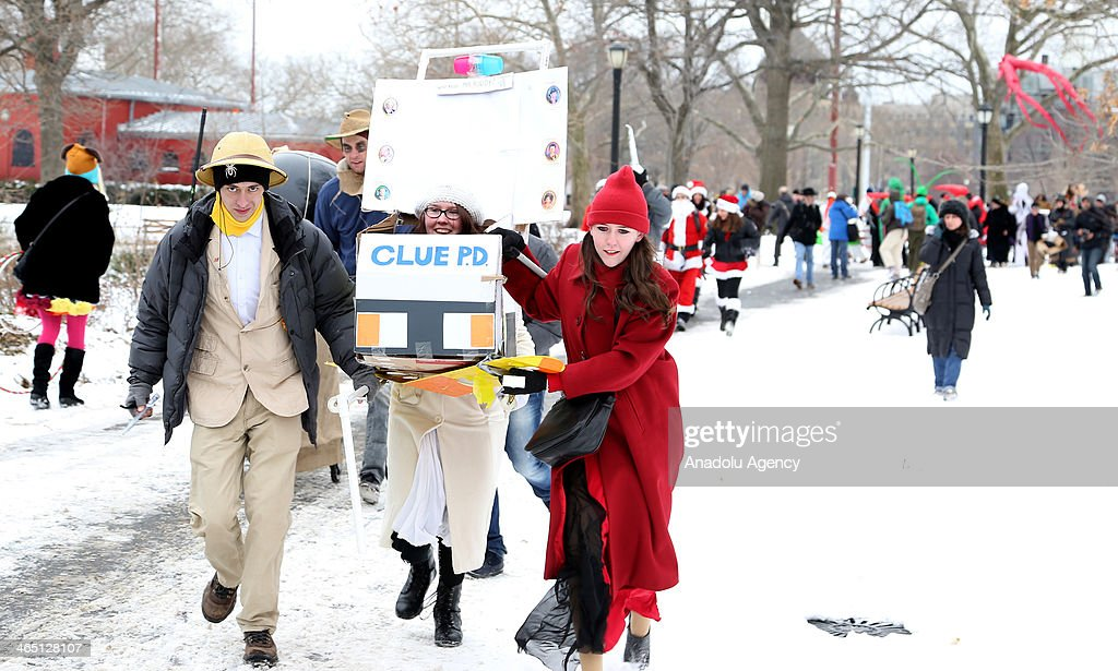 Participants take part in the 'Iditarod Race' held for the 10th time this year on January 25, 2014 in New York, United States in reaction to the 'Iditarod Trail Sled Dog Race' held in Alaska. The race starts with the cue signal of the organizers at McCarren Park in Brooklyn. Contrary to the 'Iditarod Trail Sled Dog Race', participants race with shopping carts in a unusual costumes and designs. Competitors try to complete the 1,8km length race track. Theme of alien, time machine, stove, Santa Claus, Super Mario and pirate get the most attention from the spectators.