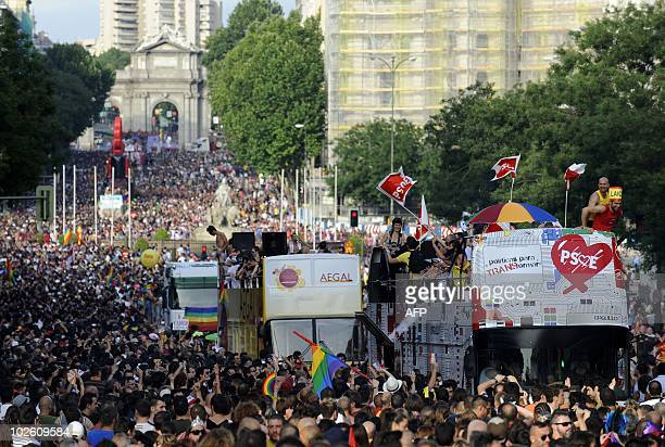 Participants take part in the Madrid Gay Pride march entitled 'For transgender equality' on July 3 2010 in the center of Madrid Thousands of people...