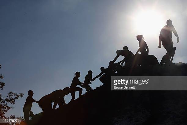 Participants take part in the Tough Mudder event at Raceway Park on October 20 2012 in Englishtown New Jersey