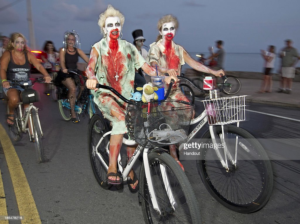 Participants take part in the zombie bike ride on the A1A next to the Atlantic Ocean on October 20, 2013 in Key West, Florida. Thousands of costumed bicycle riders participated in the event which is part of Key West's annual Fantasy Fest costuming and masking festival, that began October 18 and continues through to October 27.