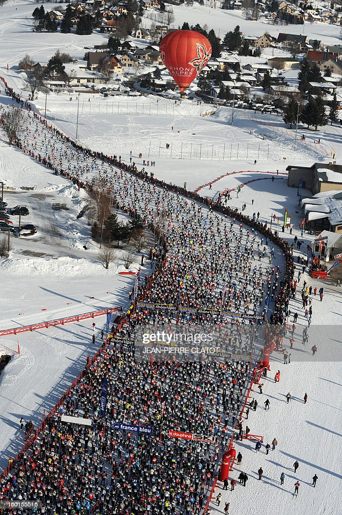 Participants take the start of the 35th 'Foulee blanche' (White stride) 42km cross country skiing race on January 27, 2013 in Autrans, French Alps. French skier Adrien Mougel won the event ahead of his compatriots Yvan Pérrillat Boitteux and Benoit Chauvet. AFP PHOTO / JEAN-PIERRE CLATOT