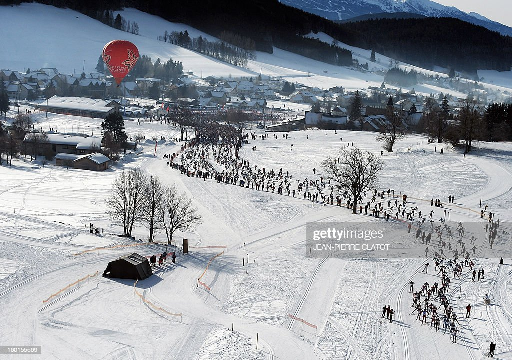 Participants take the start of the 35th 'Foulee blanche' (White stride) 42km cross country skiing race on January 27, 2013 in Autrans, French Alps. French skier Adrien Mougel won the event ahead of his compatriots Yvan Pérrillat Boitteux and Benoit Chauvet.