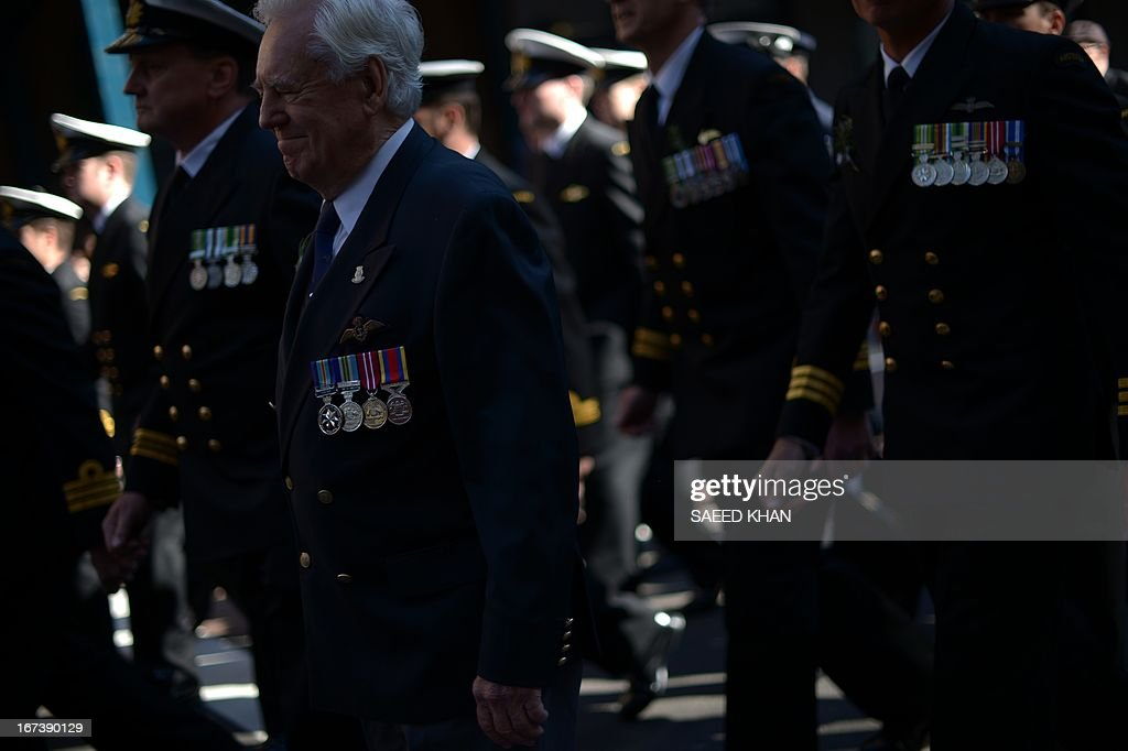 Participants takes part in the Anzac Day march in Sydney on April 25, 2013. Tens of thousands of Australians and New Zealanders turned out on April 25 to honour their war dead, with moving tributes to fallen mates and calls not to forget those injured in conflict. AFP PHOTO / Saeed Khan