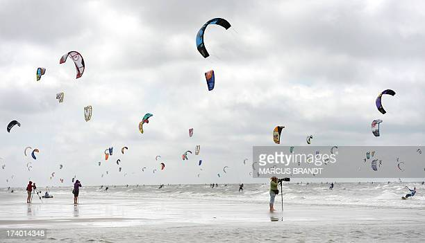 Participants train during the kite surf world cup 2013 in St PeterOrding Germany on July 19 2013 AFP PHOTO / DPA / MARCUS BRANDT GERMANY OUT