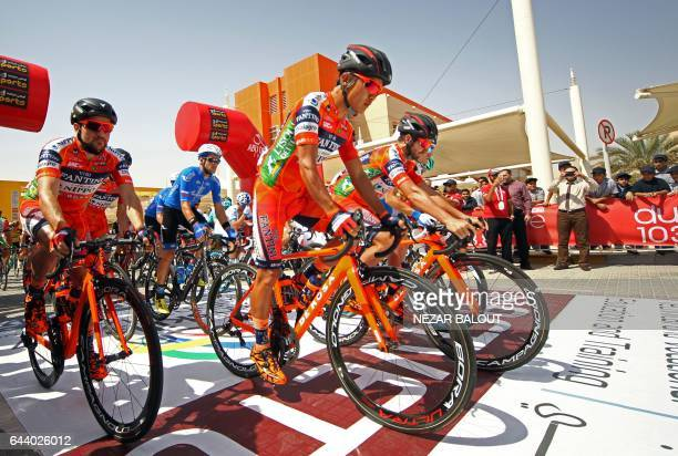Participants wait at the start line of first stage of the Abu Dhabi cycling Tour 2017 on February 23 2017 in Madinat Zayed / AFP / NEZAR BALOUT