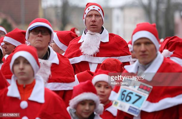 Participants wait for the start of the 5th annual Michendorf Santa Run on December 8 2013 in Michendorf Germany Over 900 people took part in this...