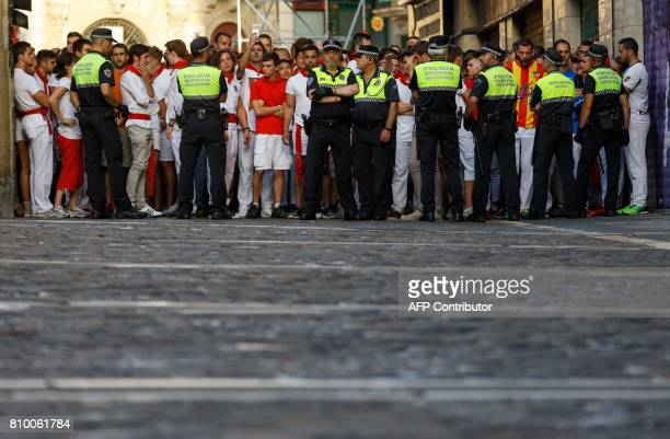 CORRECTION Participants wait for the start of the bull run on the first day of the San Fermin bull run festival in Pamplona northern Spain on July 7...