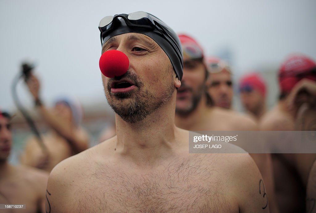 Participants wait to take part in the103rd edition of the Copa Nadal (Christmas Cup) at Barcelona's Port Vell on December 25, 2012. The traditional 200-meter Christmas swimming race gathered around 400 participants at the Old Harbour of Barcelona.