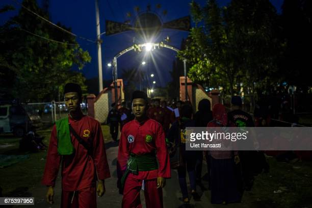 Participants walk during Pencak Dor competition at the yard of Lirboyo islamic boarding school on April 29 2017 in Kediri East Java Indonesia In...