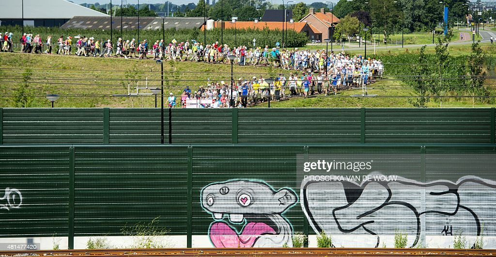 Participants walk on the first day of the 99th Four Days Marches of Nijmegen on July 21 2015 in Nijmegen AFP PHOTO / ANP / PIROSCHKA VAN DE WOUW...