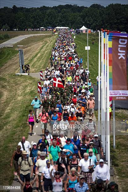 Participants walk over the dike near Lent on July 16 2012 during the first day of the International Four Day Marches Nijmegen Participants from more...