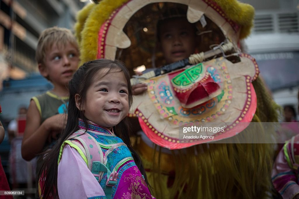 Participants walk through Chinatown during Chinese New Year celebrations in Bangkok, Thailand on February 8, 2016. The Lunar new year will mark the start of the year of the monkey and will widely celebrated throughout the country where 14 percent of the population is ethnic Chinese.