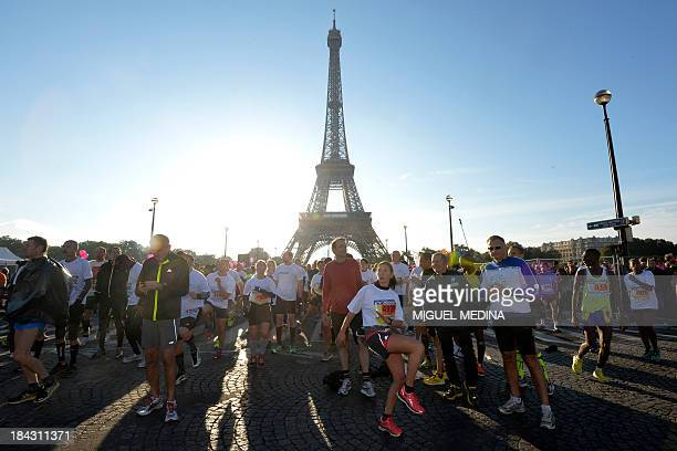 Participants warm up before the start of the 35th edition of the 20 kilometres of Paris on October 13 2013 AFP PHOTO/MIGUEL MEDINA