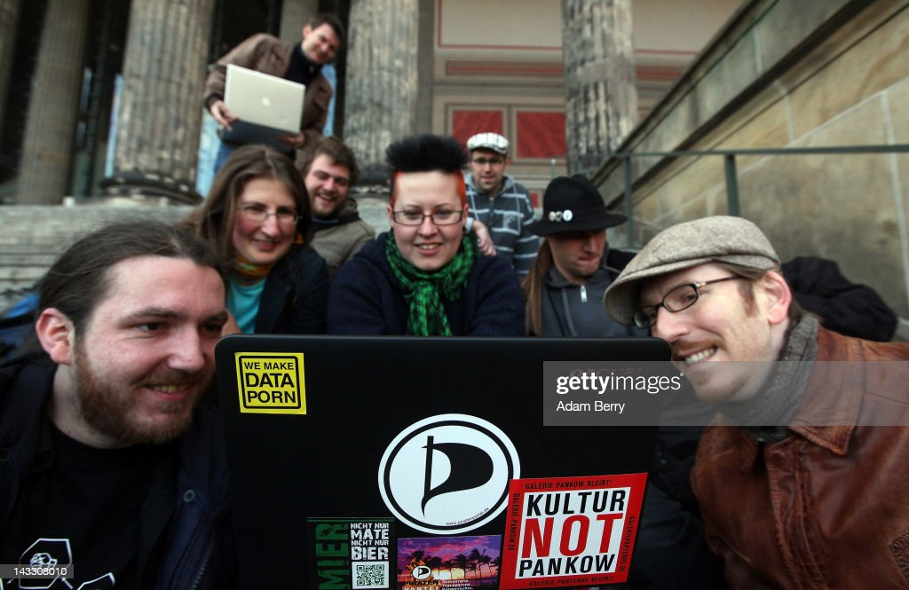 Participants watch internet videos on a laptop featuring a sticker with the logo of the Pirate Party as they wait for the start of a demonstration against Internet copyright restrictions resulting from the Anti-Counterfeiting Trade Agreement (ACTA) in front of the Altes Museum (Old Museum) on April 23, 2012 in Berlin, Germany. ACTA is a proposed treaty attempting to establish an international governing body with legal standards intended to protect intellectual property and prevent the production and sale of counterfeit goods. The German government has delayed a decision on the agreement, citing concerns by the Justice Ministry, and according to news reports is waiting for approval by the European Parliament prior to signing the multinational treaty.