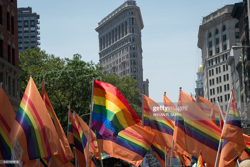 Participants wave flags during the 46th annual Gay Pride march June 26, 2016 in New York. New York kicked off June 26 what organizers hope will be the city's largest ever Gay Pride march, honoring the 49 people killed in the Orlando nightclub massacre and celebrate tolerance. / AFP / the 46th / Bryan R. Smith
