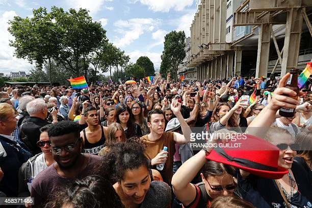 Participants wave rainbow flags during the Gay Pride parade in Paris on July 2 2016 / AFP / FRANCOIS GUILLOT