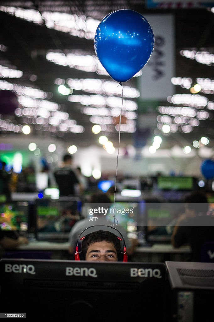 Participants wear balloons on their headphones during the Campus Party event, in Sao Paulo, Brazil, on January 30, 2013. About 8,000 hackers, developers and geeks are expected to attend the annual weeklong, 24-hours-a-day technology event which first started in Spain in 1997 and now spread into various countries. AFP PHOTO/Yasuyoshi CHIBA