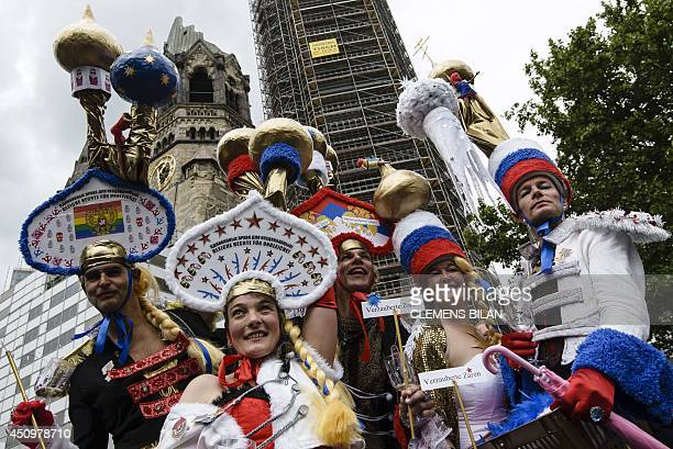 Participants wear hats featuring Russian church domes during the Christopher Street Day gay pride parade in front of Berlin's Memorial Church in...