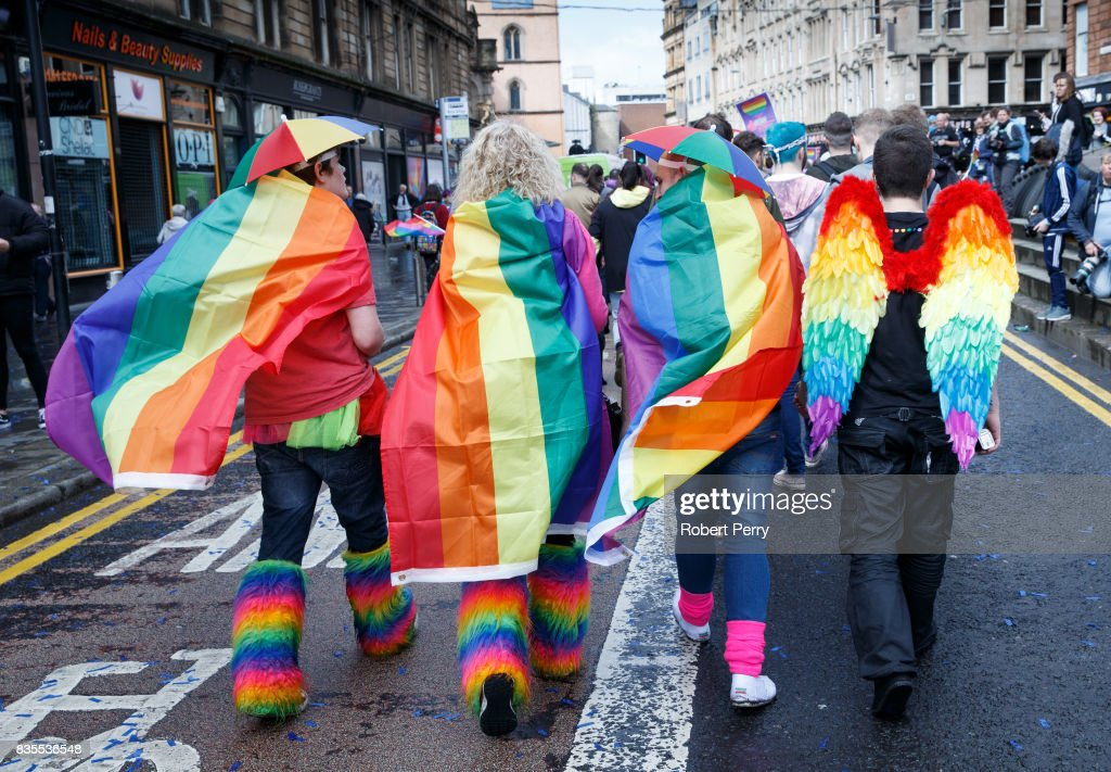 Participants wear rainbow flags and angel winfs during the Glasgow Pride march on August 19, 2017 in Glasgow, Scotland. The largest festival of LGBTI celebration in Scotland has been held every year in Glasgow since 1996.
