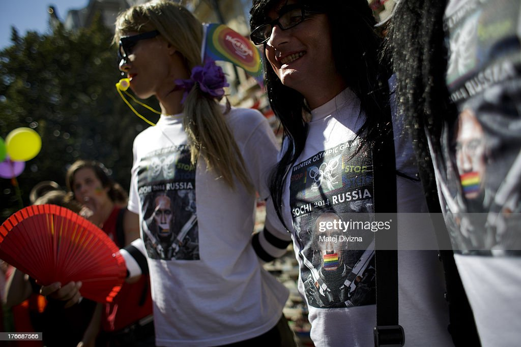 Participants wear t-shirts with protest picture against Russian President Vladimir Putin during the third Prague Pride March on August 17, 2013 in Prague, Czech Republic. Several thousand people marched through city centre in support of Lesbian, Gay, Bisexual and Transgenders (LGBT) rights.