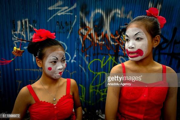Participants wearing colorful costumes to attract the tourists attend the annual carnival themed 'Batik is My Life' in Surakarta Central Java...