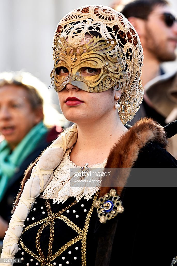 Participants wearing costumes are seen at the Piazza Navona, one of the tourist area of the city, during a carnival, which is held every year on February, in Rome, Italy on February 6, 2016.