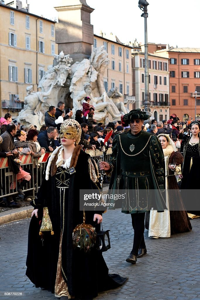 Participants wearing costumes parade at the Piazza Navona, one of the tourist area of the city, during a carnival, which is held every year on February, in Rome, Italy on February 6, 2016.