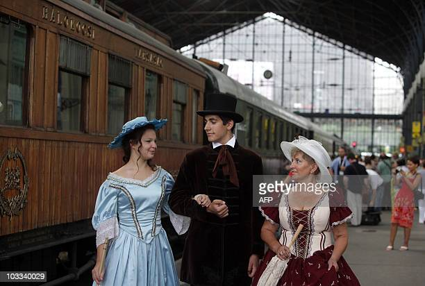 Participants wearing historical dress of the 19th20th century wait for the departure of the famous 'Orient Express' train in the Westend railway...